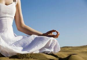 Women Meditating on Beach