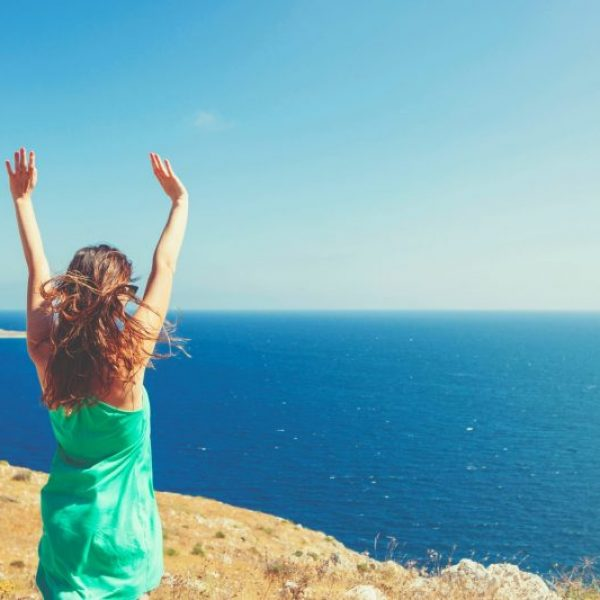 Happy lady looking at ocean